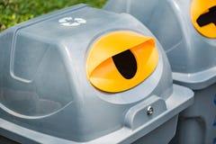 Recycle bin in garden Royalty Free Stock Photos
