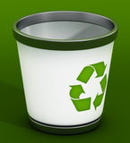 Recycle bin on green background Royalty Free Stock Photography