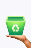 Recycle bin on hand Royalty Free Stock Images