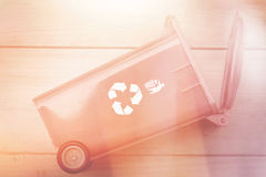 recycle bin trash bin with recycle logo on wood background vinta Stock Images