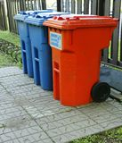 Recycle bins. For plastic and glass bottles and waste paper royalty free stock image