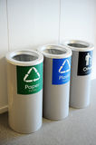 Recycle bins. Three recycle bins inside a shopping mall Stock Image