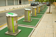 Recycle Bins. A long row of differently coloured recycling bins located on a Spanish Street Royalty Free Stock Photo