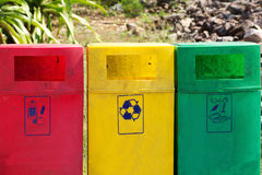 Recycle bins. Three colors recycle bins in public garden Stock Images