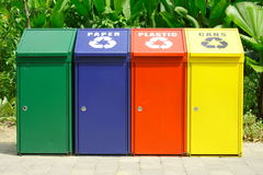 Recycle bins. For plastic bottles, aluminium cans and waste paper Stock Photos