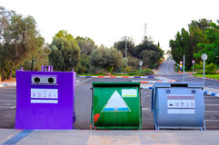 Recycle Bins. Colorful recycle bins for glass, paper and plastic stock photo