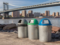 Recycle bins in front of the Manhattan Bridge Royalty Free Stock Images