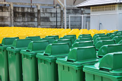 Recycle bins in a group made of commercial size yellow and green Stock Photography