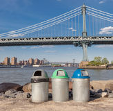 Recycle bins with the Manhattan Bridge Background. Recycle bins for different kind of garbage with the Manhattan Bridge Background Stock Images