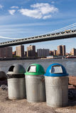 Recycle bins near riverside around the Manhattan Bridge Stock Photo