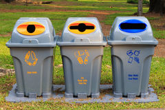 Recycle bins at public park. Public garbage bins. Stock Images