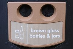 Recycling waste management for brown glass bottles and jars Stock Image