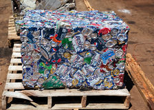 Recycle Can Cube. COEUR D'ALENE, ID - July 7:  A compressed cube of aluminum cans sits on a wooden pallet in the sunshine at a recycling yard on July 7, 2011 in Stock Images