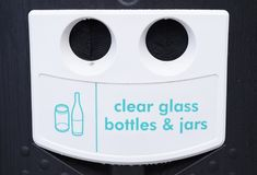 Recycle clear glass bottles and jars waste management storage bank Stock Photography