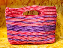 Recycle color plastic handmade bag on recycle compressed wood ch. Ippings board royalty free stock image
