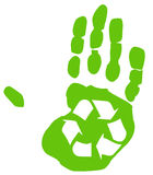 Recycle concept. Green recycle symbol inside the print of a hand Royalty Free Stock Images
