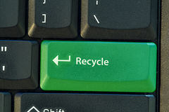 Recycle green button. On black keyboard Royalty Free Stock Photo