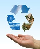 Recycle hand. One hand care the recycle logo, water, air and soil Stock Image