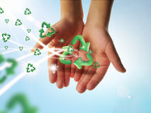 Recycle hands. Eco concept with hands and logo of recycle Stock Photography