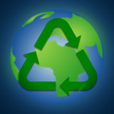recycle icon on the earth Royalty Free Stock Photography