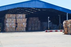 The recycle industry cardboard garbage and paper waste after pressing in hydraulic baling garbage press machine to a square dense