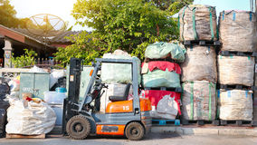 Recycle industry. Forklift and waste big bag for recycle industry Royalty Free Stock Photos
