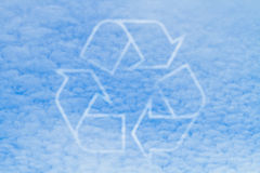 Recycle logo. Shaped clouds in the blue sky Stock Photos