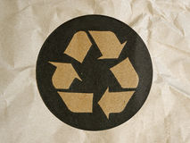 Recycle logo on crumpled brown paper background Stock Photo