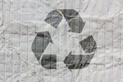 Recycle logo on old paper Stock Photo