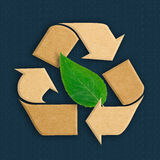 Recycle logo from recycled cardboard with green leaf Stock Photo