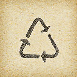 Recycle logo on recycled paper background Royalty Free Stock Photos