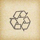 Recycle logo on recycled paper background Stock Photography