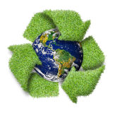 Recycle logo symbol from the green grass and earth. Royalty Free Stock Photo