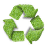 Recycle logo symbol from the green grass. On white Stock Photo