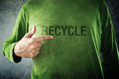 RECYCLE. Man pointing to title printed on his shirt royalty free stock photography