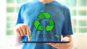 Recycle with man using a tablet royalty free stock photo