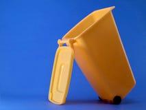Recycle. A miniature orange recycling bin Stock Photos