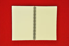 Recycle notebook. On red background stock image