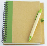 Recycle notebook and a pen.  Royalty Free Stock Image