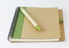 Recycle notebook and a pen.  Stock Images