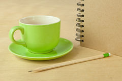 Recycle notebook and wooden pencil Stock Photo