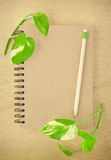 Recycle notebook and wooden pencil Royalty Free Stock Photo