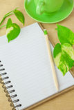Recycle notebook and wooden pencil Royalty Free Stock Images