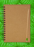 Recycle notebook and wooden pencil Royalty Free Stock Photography