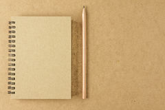 Recycle notebook and wooden pencil on wood background . Stock Photos