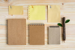 Recycle notebook with wooden pencil on wooden desk Royalty Free Stock Photo