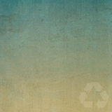Recycle on old paper texture Royalty Free Stock Photos