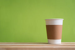 Recycle paper cup. Paper cup with Sleeve on green background Stock Photography