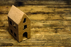 Recycle paper house on wooden table Royalty Free Stock Photos