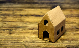 Recycle paper house on wooden table Stock Photography